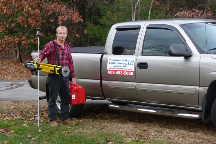 Randy Donckers carrying one-man Leica robotic land survey equipment